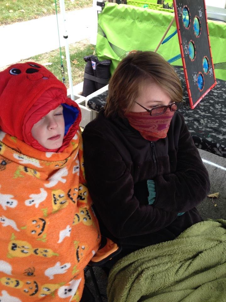 Haydenn and Sydnee sitting in the cold at the TLT booth at the 2013 Irvington Halloween Festival!